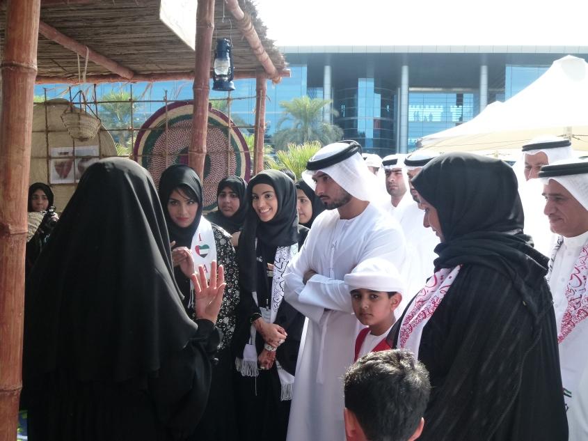 His Highness Sheikh Majid bin Mohammed bin Rashid Al Maktoum listening to a presentation during the National Day Celebrations at Zayed University