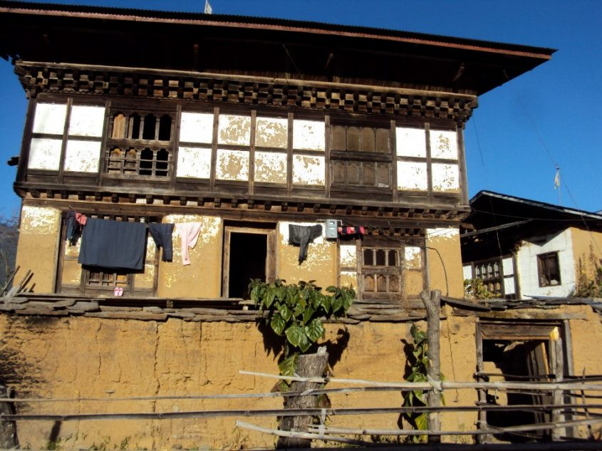 A Bhutanese farmhouse with pounded mud making up its foundations