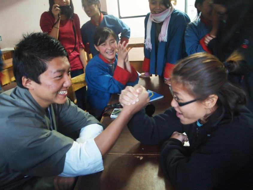 Ms Chan happily accepted a challenge at hand-wrestling issued by a student from Punakha Higher Secondary School