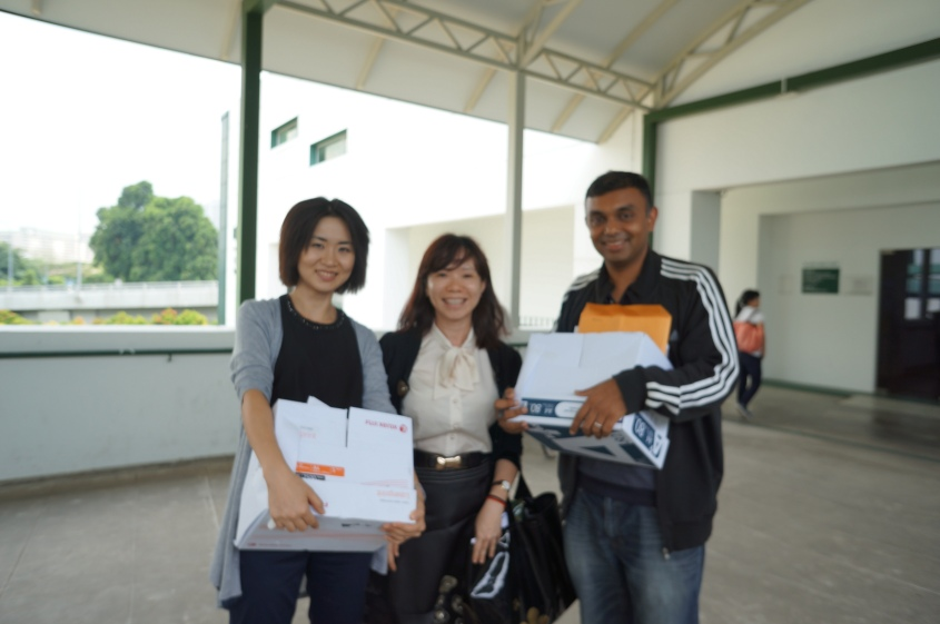 Civics Tutors carrying result slips to the MPH prior to the release of results.