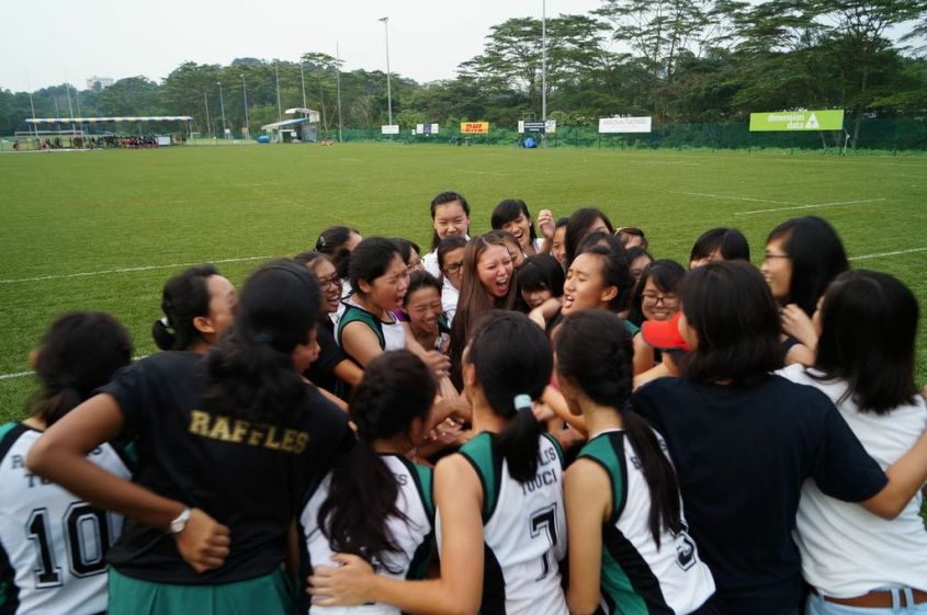 Let's go Raffles! – the team and alumni huddle before the match