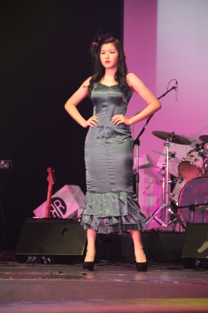 This dress channeled elements from the Victorian era with its deep grey colour and ruffles lining the edge of the dress
