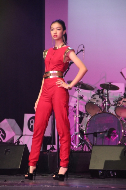 This playful fiery-red jumpsuit also featured a plunging back