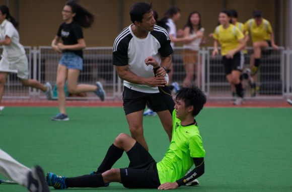 The pain on missing out on the championship title is written all over Benjamin Ang's face. Mr Azmy helps him up.