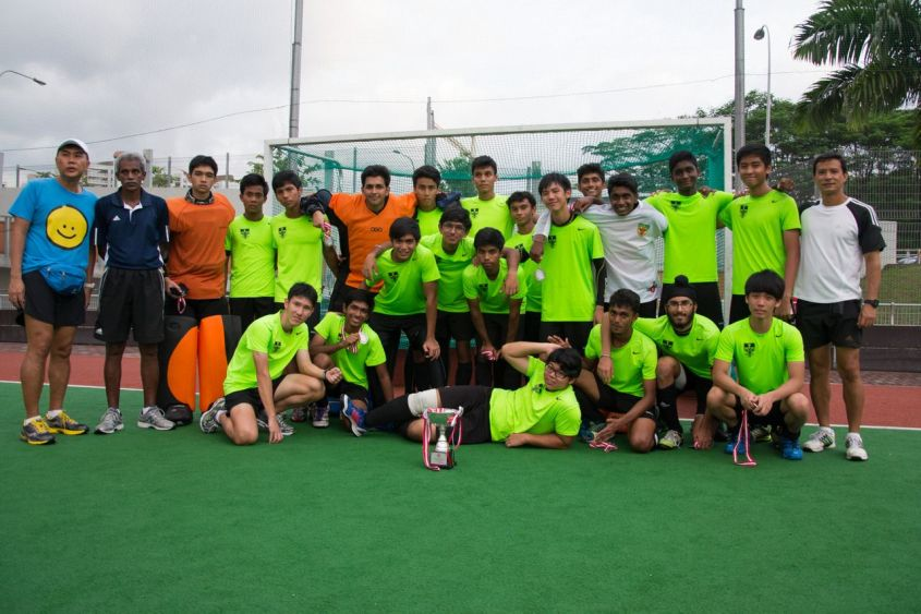 The Hockey Boys' Team posing for a team photo with their first runners' up medals