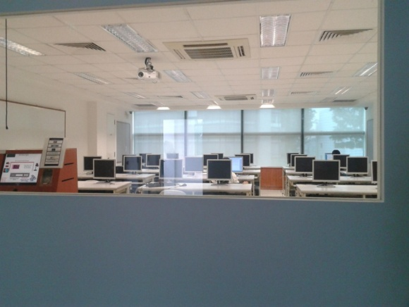 Notice how all the computer monitors point toward the transparent glass window. Strictly for work!