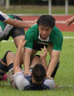 Matthew Tjoeng (RI) taking out his opponent