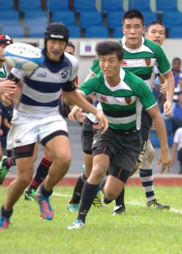 Samuel Goh (RI) sprints for the ball