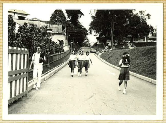 Mr Chan (left) leaving the Grange Road campus via its Kay Poh gate