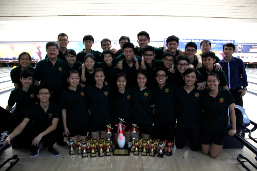 Framing it up: RI Bowling poses for the camera with their awards lined up before them