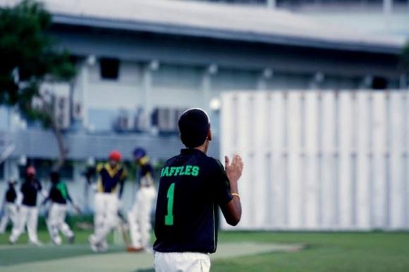 Lakshan Srinivas applauds after the team claims an ACS (I) wicket