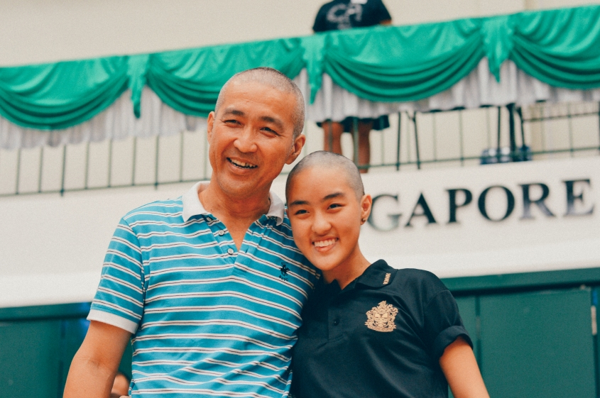 Ceremonial shavees Shermaine Ng and her father