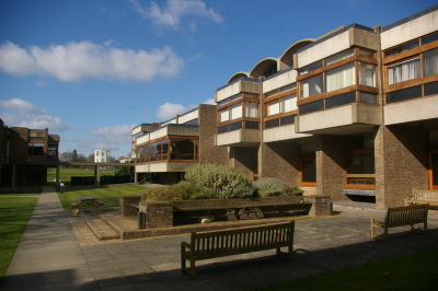 The modern-looking Churchill College, which was named after Winston Churchill. [Source: http://c1038.r38.cf3.rackcdn.com/group1/building1597/media/media_37545.jpg]