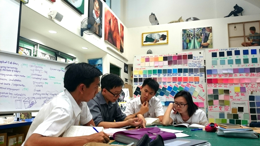 H3 Art students engaging in a discussion with their tutor, Mr. Chia.