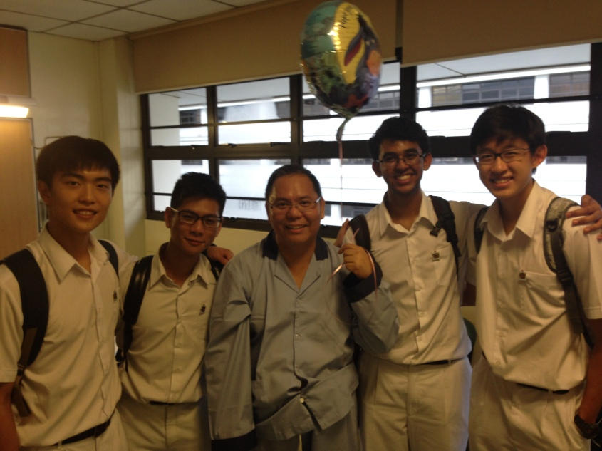 Mr Chan being visited by RI students during his recuperation