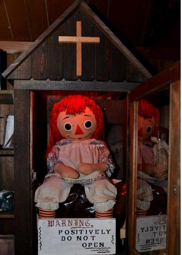 The encased Annabelle doll in the Warrens' home in Connecticut
