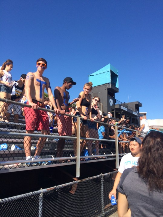 Enthusiastic students at the university's Homecoming game