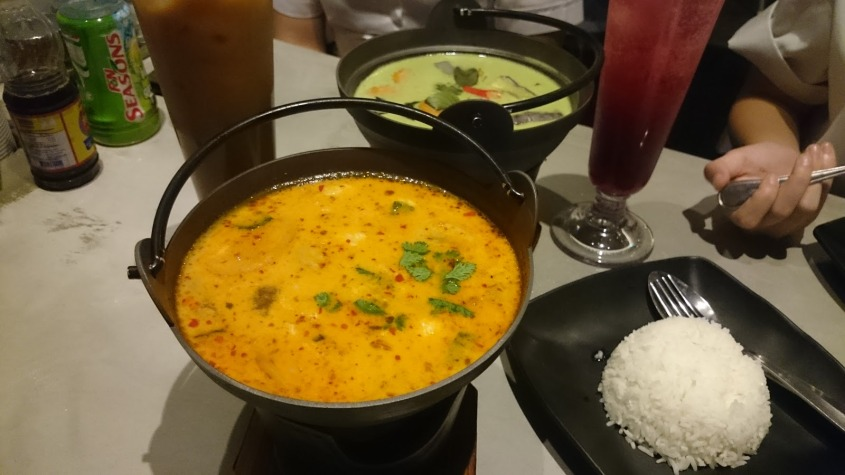 The Tom Yam Seafood Soup alongside the Thai Green Curry