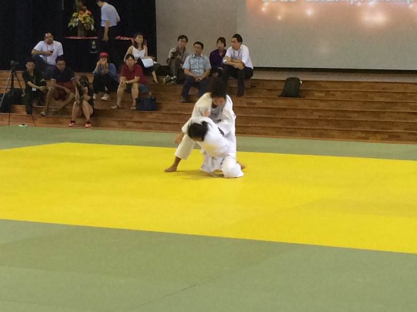 Fadhillah (above) grappling with her opponent