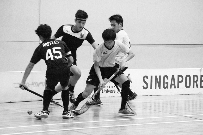 Amirul and Jun Jie grappling for the ball.