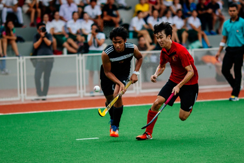 Ryan Jay Naidu (#13) contesting for the ball with an opposing player.