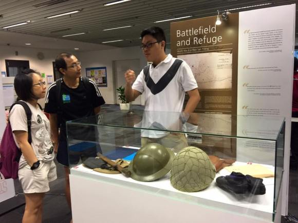 A RI volunteer explaining the WW2 history of Bishan.