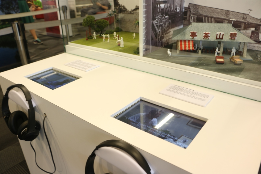 Carefully built dioramas of places that once stood in  Kampong San Teng, along with displays to watch clips of interviews with former kampong residents.
