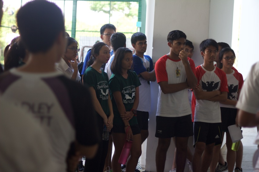 Participants listening intently to an explanation of the game's rules before the game commences.