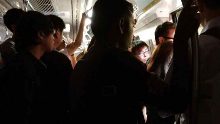 Commuters experienced some darkness as the main lights on the train went out. (Source: Channel News Asia [CNA])